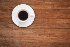 Close up white coffee cup on wooden table Royalty Free Stock Image