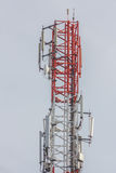 Close up white color antenna repeater tower on blue sky Stock Photo
