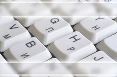 Close-up of the white computer classic keyboard with english and russian letters with copy space fiel. D stock photos