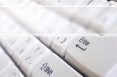 Close-up of the white computer classic keyboard with english and russian letters with copy space fiel. D royalty free stock photography