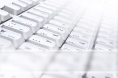 Close-up of the white computer classic keyboard with english and russian letters with copy space fiel. D royalty free stock photos