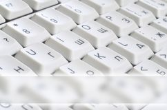 Close-up of the white computer classic keyboard with english and russian letters with copy space fiel. D stock images