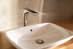 CLose up white comtemporary  luxury washbasin, tap. CLose up white comtemporary luxury washbasin and metal tap Stock Photography