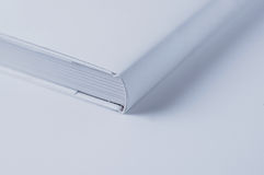 Close up of white cover book on white background. Closed white cover book Royalty Free Stock Photos