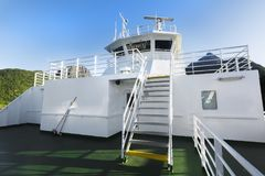 Close up of white cruise liner or ferry ship and blue sky Royalty Free Stock Photos