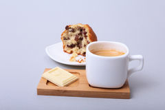 Close-up of white cup of cappuccino coffee and chocolate cake Royalty Free Stock Photos