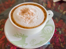Close up white cup of Coffee, latte on the glasses table Royalty Free Stock Photos