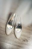 Close up of white elegant and stylish bridal shoes Stock Photos