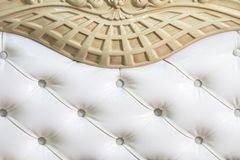 Close-up white fabric upholstered headboard with buttons textile background, retro Stylish bedroom furniture royalty free stock photography
