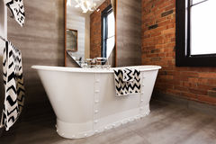Close up of white freestanding bat tub. In vintage interior styled bathroom stock photography