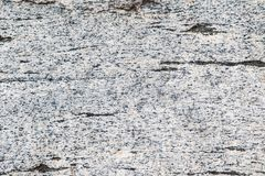 White smooth granite texture. Close up of a white granite block revealing its texture Royalty Free Stock Images