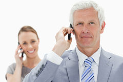 Close-up of a white hair businessman on the phone with a smiling Stock Image