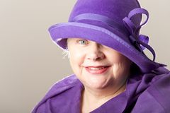 Close-up of white-haired woman in purple hat Stock Photo
