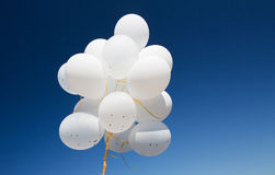 Close up of white helium balloons in blue sky Royalty Free Stock Photography