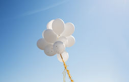 Close up of white helium balloons in blue sky Royalty Free Stock Images