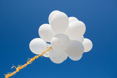 Close up of white helium balloons in blue sky Royalty Free Stock Photos