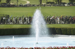 A close-up of the White House south fountain. As military members in the background carry the fifty state flags on May 7, 2007, as part of the welcoming of Her Stock Photography