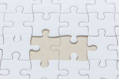 White jigsaw puzzle with missed piece. Close up of White jigsaw puzzle with missed piece royalty free stock images