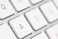 Close up of a white keyboard english alphabet Stock Photo