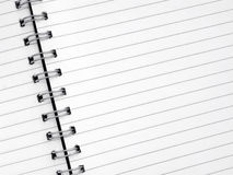 Close up white lined paper in a spiral notepad. Royalty Free Stock Image