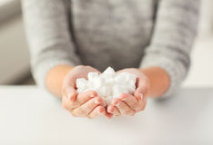 Close up of white lump sugar in woman hands Royalty Free Stock Image