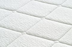 Close-up of white mattress texture. Stock Photos