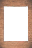 Close up White notebook paper on grunge wood background Stock Photos