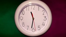 Close up of an white office clock on colorful. Close up of an office clock on colorful background with clipping path stock footage
