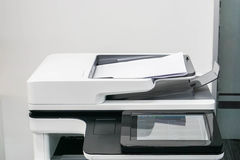 Close up white office printer with mock up paper sheet Royalty Free Stock Photo