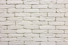 Close-up of white painted whitewashed solid brick wall. Abstract copy space background, Bricklaying, construction and masonry. Concept royalty free stock photo