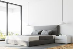 White panoramic bedroom corner close up. Close up of a white panoramic bedroom with a wooden floor, a double bed and a magnificent window view. 3d rendering mock Royalty Free Stock Photo