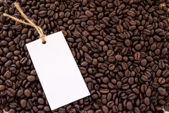 Close up white paper card on coffee beans Stock Photos
