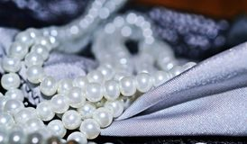 Pearls and fabric close-up Stock Image
