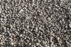 Close up of white pebbles on a beach stock photos