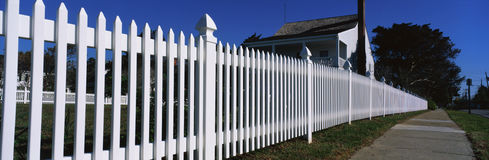 Close up of a white picket fence Stock Photo