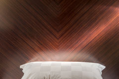 Close up white  pillow and wooden wall Stock Photos