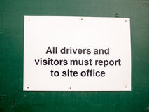 Close up of white placard sign all drivers and visitors must rep. Ort to site office; England; UK Stock Photography