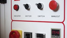 Close-up of white plant equipment control switch panel. Modern automated industrial plant enterprise control panel. Footage. Concept of automatic machine stock image