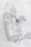Close up of white present box with silver ribbon for christmas Stock Photos