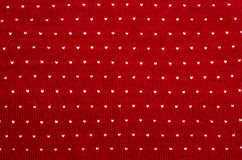 Close up on white and red heart dots woolen texture. Stock Photo