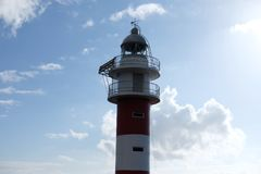 Close-up of white and red lighthouse stock images