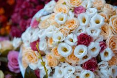 Close up on white and red roses wedding bouquet top view.  Stock Photos