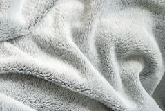 Close up white shaggy artificial fur texture or carpet for background stock image