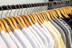 Close up white shirt hanging in wardrobe. Royalty Free Stock Image