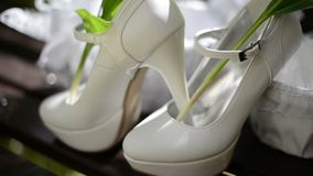 Close up of white shoes of the bride