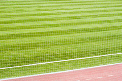 Close up of white soccer net on green background Royalty Free Stock Image