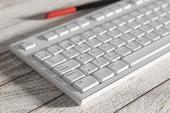 Close-up of white spanish keyboard on wooden table Stock Photography