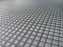 Close up white square textile floor cover Stock Image