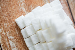Close up of white sugar pyramid on wooden table Royalty Free Stock Images