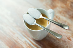 Close up of white sugar on teaspoon and coffee cup Stock Images